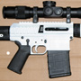 """White Hunter"": JP Enterpriser LRP-07H in 308 Winchester with U.S. Optics SN3 5-25x58 T-Pal MDMOA 35mm installed with 35mm Badger Ordnance rings."